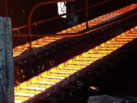 Iron is being casted into ingots by weight of 15-20 kg